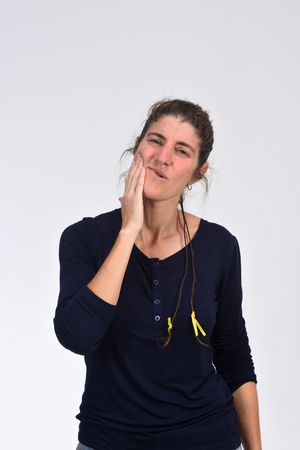 middle-aged woman with a toothache on white background Archivio Fotografico