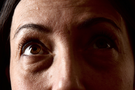 skin texture of eyes middle aged woman Stock Photo