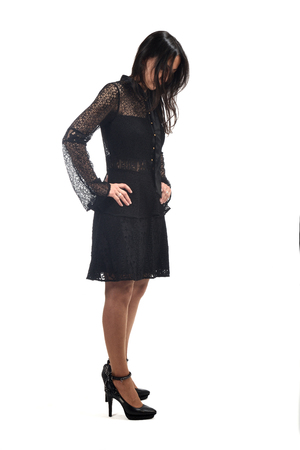 full portrait of a middle age woman with dress and heeled shoes isolated on white