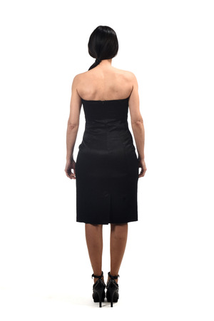 full portrait of a woman from behind with off the shoulder dress on white Stock Photo