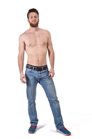 man shirtless and with blue jeans on white background