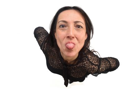 woman sticking out her tongue on white