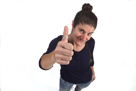 woman with thumb up on white