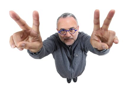 man making the victory sign on a white background