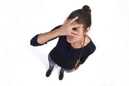 woman peeking with hand on face on white background