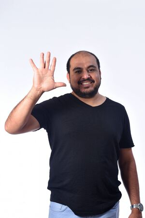 latin american Man with finger in the shape of number five Zdjęcie Seryjne