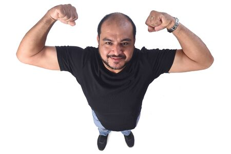 latin american man doing strength on a white background