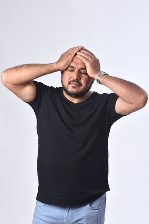 latin american man with headache on white background