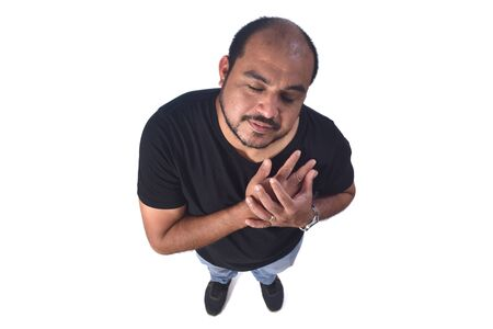 latin american man with hand on heart on white background Zdjęcie Seryjne