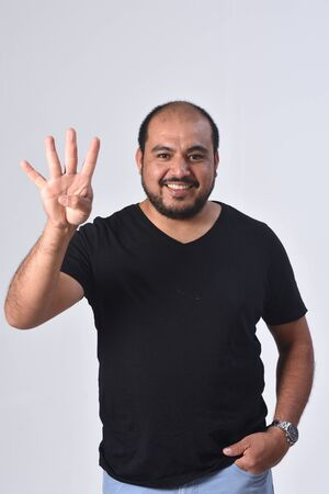 latin man with finger in the shape of number four
