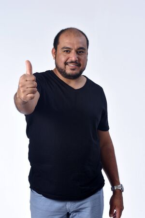 latin american man thumps up on white background Zdjęcie Seryjne