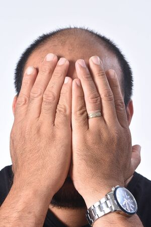 latin american man cover his face with his hand Zdjęcie Seryjne