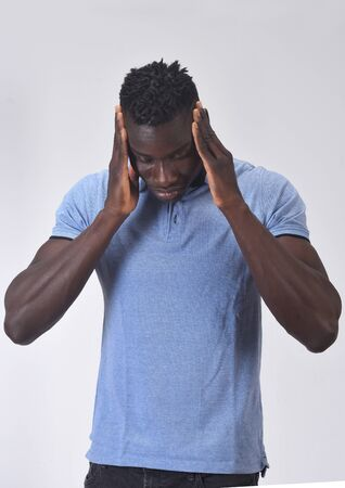african man with headache on white background Stockfoto