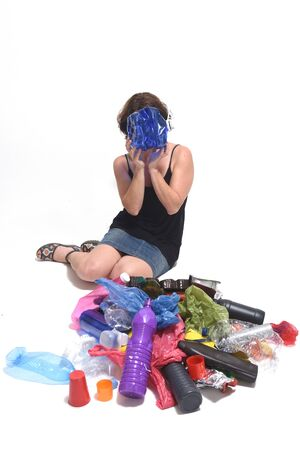 woman with a plastic bottle on her face