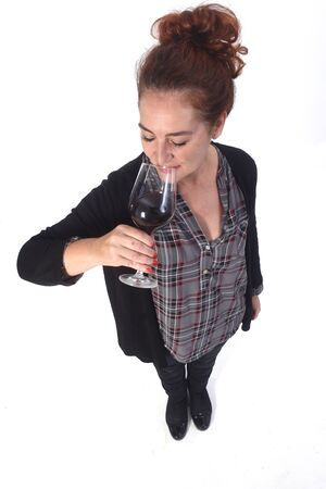 woman with a coup of red wine on white background