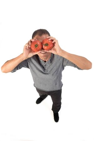man with tomatoes on white background Banque d'images