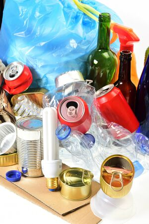 garbage consisting of cans, plastic bottles, glass bottle, carton, cans and bulb