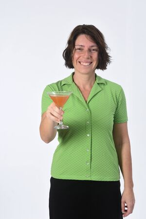 woman with a cup of cocktail on white background Фото со стока