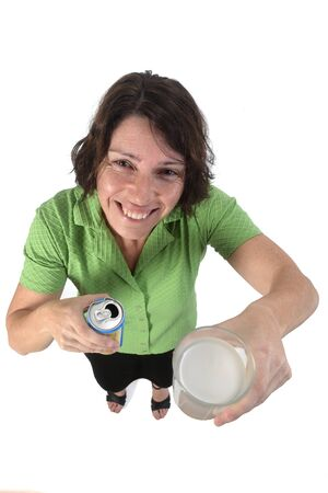 woman with a glass of lemon soda on white background