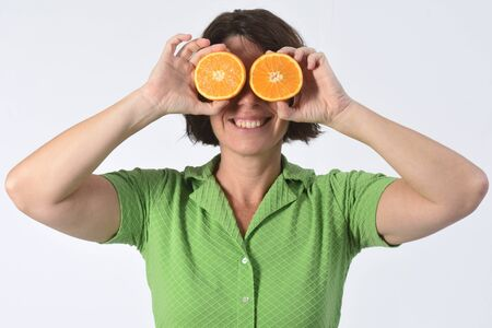 woman with orange fruit on white background