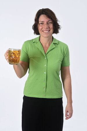 woman with beer on white background Фото со стока