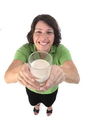 woman with a glass of milk on white background Фото со стока