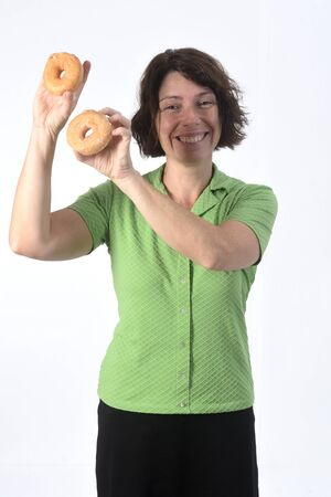 woman with a donut on white background Фото со стока