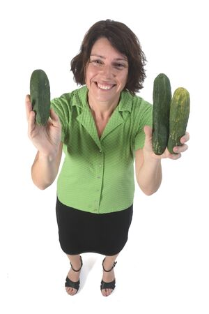portrait of a woman with cucumber on white background