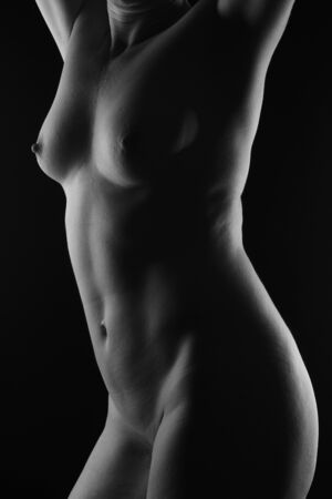 middle aged woman nude on black background Archivio Fotografico