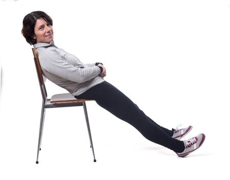 portrait of a woman lying on a chair in white background