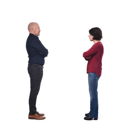 couple facing each other on white background, arms crossed