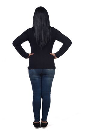 rear view of woman on white background,, hands on hip