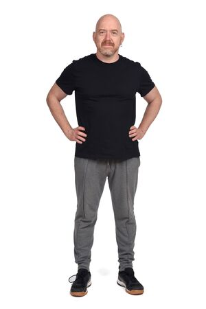 man with sportswear and hands on hip on white background