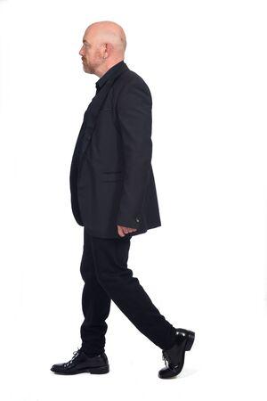 man with blazer walking on white background