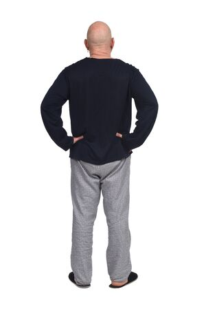 portrait of a man from the back with pajamas and slippers