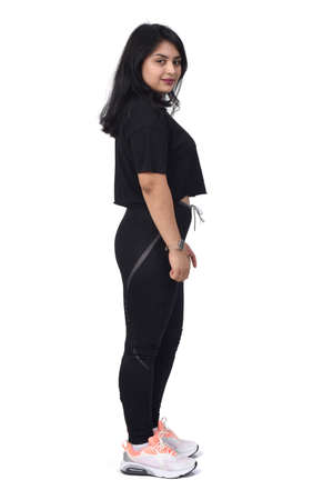 side view of a latin woman with sportswear looking at camera on white background 版權商用圖片 - 155047196