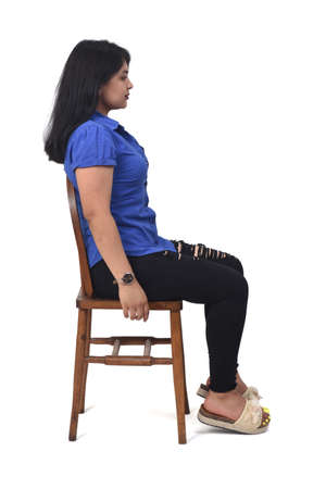 rear view of a woman sitting on a chair and looking at camera on white background, 版權商用圖片 - 155047304