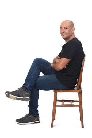 rear view of a bald man on white background, arms crossed