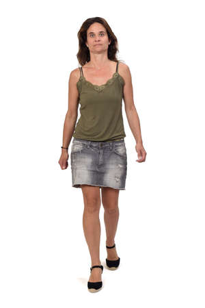 rear view of a full portrait of a woman in a denim skirt on white background,