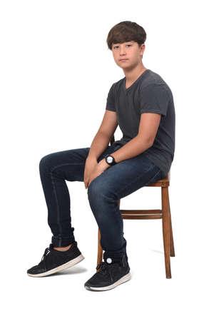 rear view of teenager boy wearing sportswear standing on white background, Zdjęcie Seryjne