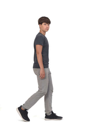 front view of cool teenager boy wearing sportswear standing on white background,