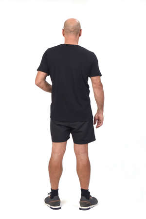 side view of a man wearing sportswear t-shirt and shorts on white background, 版權商用圖片