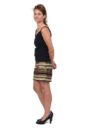 full portrait of a woman with skirt on white background, side view and looking at camera 版權商用圖片