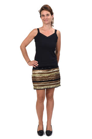 full portrait of a woman in a skirt on white background, smiling and hand on hip