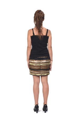 rear view of a full portrait of a woman in a skirt on white background,