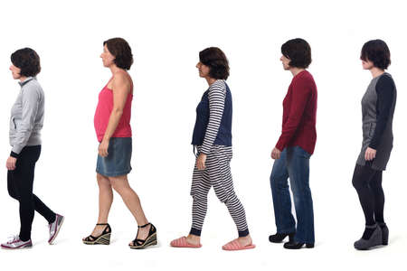 woman dressed in different outfits like sportswear, blue jeans, dress,skirt and pajamas walking on white background 版權商用圖片