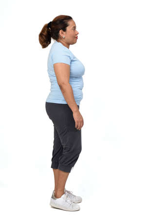 side view of a woman with sportswear on white background,