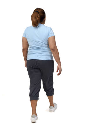 rear view of a woman with sportswear walking on white background,
