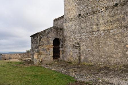 the side of the Romanesque church of Sant Miquel de Olerdola, Barcelona province, Catalonia, Spain Stock Photo