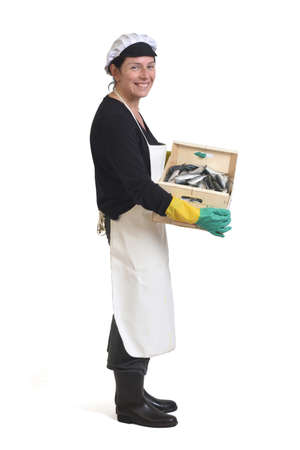 full portait of a fishmonger with a box of sardines on white background, side view Banque d'images